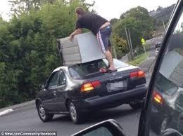man on car roof